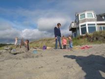 Sunny beach and house behind us.