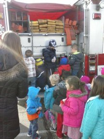 Joining in with all the little kids climbing up the back of the firetruck.